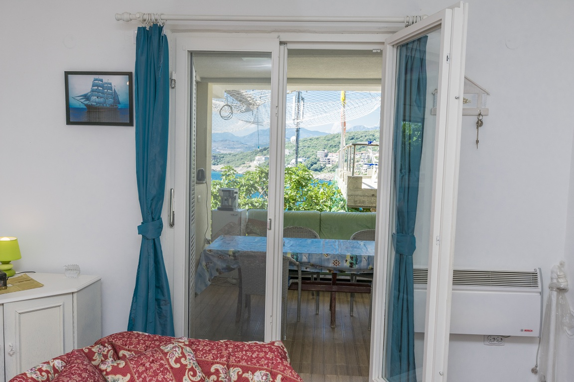 Livingroom with single beds of apartment for rent Utjeha Montenegro