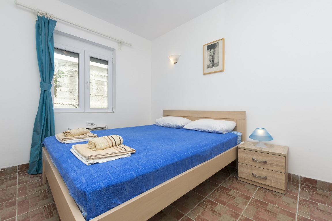 Bedroom with king bed of apartment for rent Utjeha Montenegro Mediterranean Europe